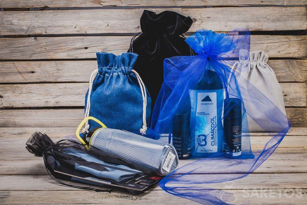 Cosmetici, gadget sportivi - regali per uomo in eleganti borse in tessuto